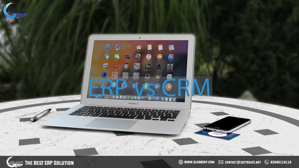 Laptop computer and discussing the differences and similarities between erp and crm